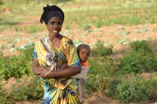 A mother and child on farmland managed by Development and Peace in Ethiopia 2015.