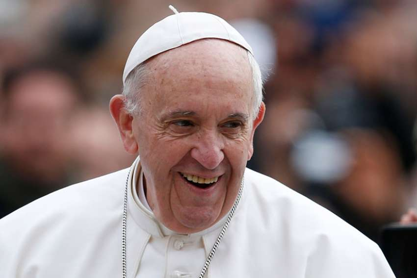 Pope Francis smiles during his general audience in St. Peter's Square at the Vatican March 22.