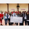 Loretto Abbey raised almost $5,000 for the Loretto Sisters' school in South Sudan when the school's hockey team took on a staff team led by coach Steve Malvaso, far left, in the annual Charity Cup April 4. The teams skated to a 5-5 draw.