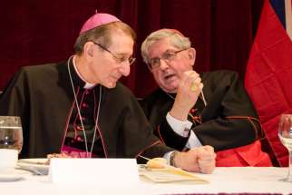 Papal Nuncio to Canada, Archbishop Luigi Bonazzi, speaks with Cardinal Thomas Collins at the annual Cardinal's dinner.