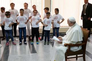 Children perform as Pope Francis visits with refugees in Sofia, Bulgaria, May 6, 2019.