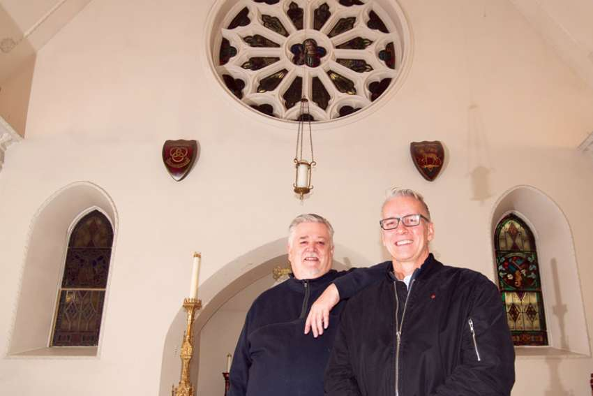 Fr. Michael Busch, rector of St. Michael's Cathedral, at left, with Marc Ferguson of Buttcon Ltd., the lead contractor on the renovations the cathedral is undergoing.