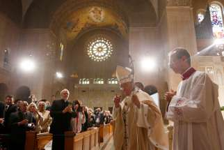Pope Francis walks through the Basilica of the National Shrine of the Immaculate Conception as he arrives to celebrate Mass and the canonization of Junipero Serra Sept. 23 in Washington.