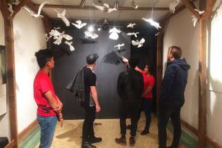 An indoor art installation for Nuit Blanche at Toronto's Msgr. Fraser College highlights the migrant's journey.