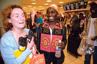St. Gertrude's parishioner Margaret Cirtwell meets Sudanese refugee Abdul Karim Mohammed at Pearson International Airport.