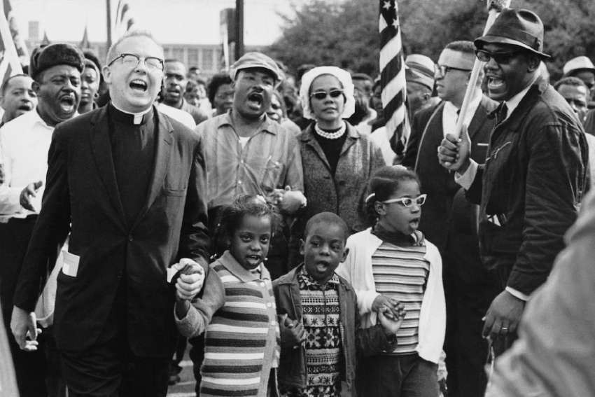 Clergy joined the famous Selma to Montgomery march in 1965, a key moment in the history of the civil rights movement  in the U.S. The march featured Martin Luther King Jr. and his wife Coretta (centre), as well as movement co-founder Ralph Abernathy and his children, who joined hands with the unidentified clergyman.
