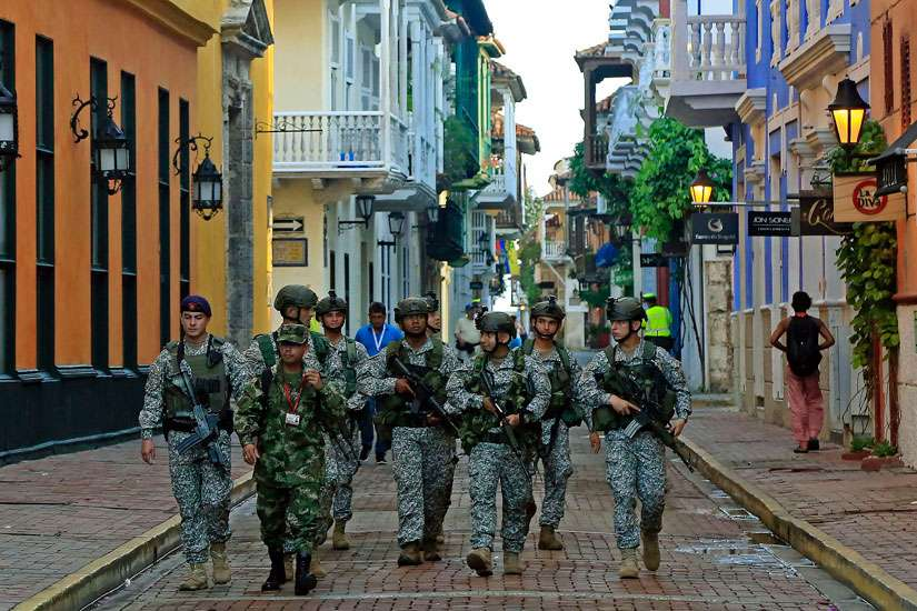 Colombian soldiers patrol Cartagena prior to the signing of a peace deal between the government and the Revolutionary Armed Forces of Colombia guerrillas Sept. 26.