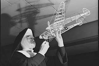 Sr. Mary Aquinas checks out a model airplane. The nun earned many honours and accolades during her life for her work in both education and aeronautics.