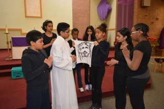 St. Sylvester Catholic School students perform their rendition of Three Trees lead by lead actor John Porathur, Grade 7, who played Jesus Christ.