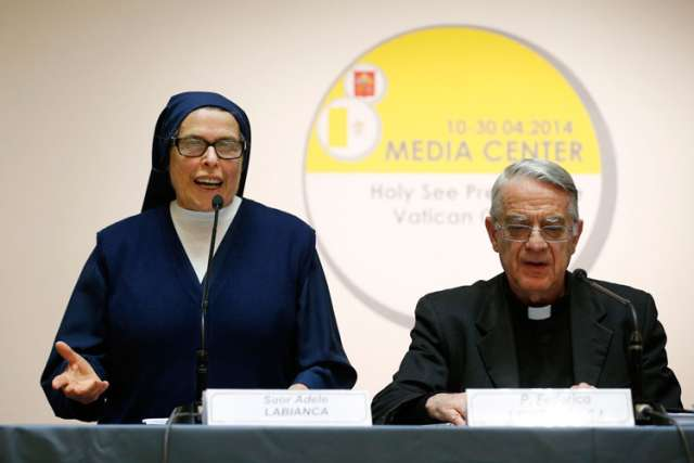Daughter of Charity Sister Adele Labianca speaks during a press conference at the Vatican April 24 in advance of the canonization of Blesseds John XXIII and John Paul II. At right is Jesuit Father Federico Lombardi, the Vatican spokesman. Sister Labianca gave her eyewitness account of the healing of Sister Caterina Capitani, the nun whose healing in 1966 was accepted as the miracle needed for the beatification of Pope John XXIII.