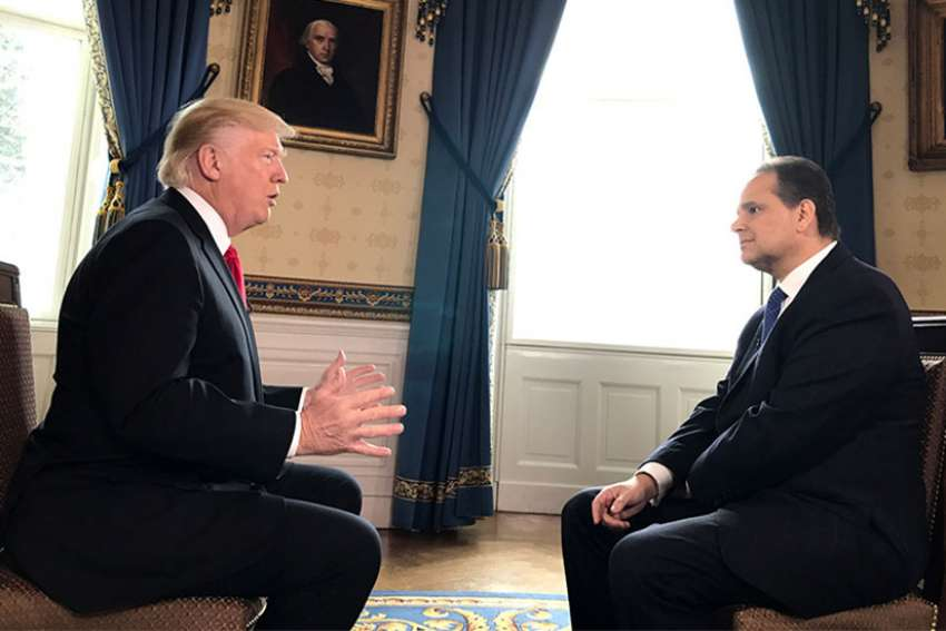 Christian Broadcasting Network chief political correspondent David Brody, right, interviews President Trump at the White House.