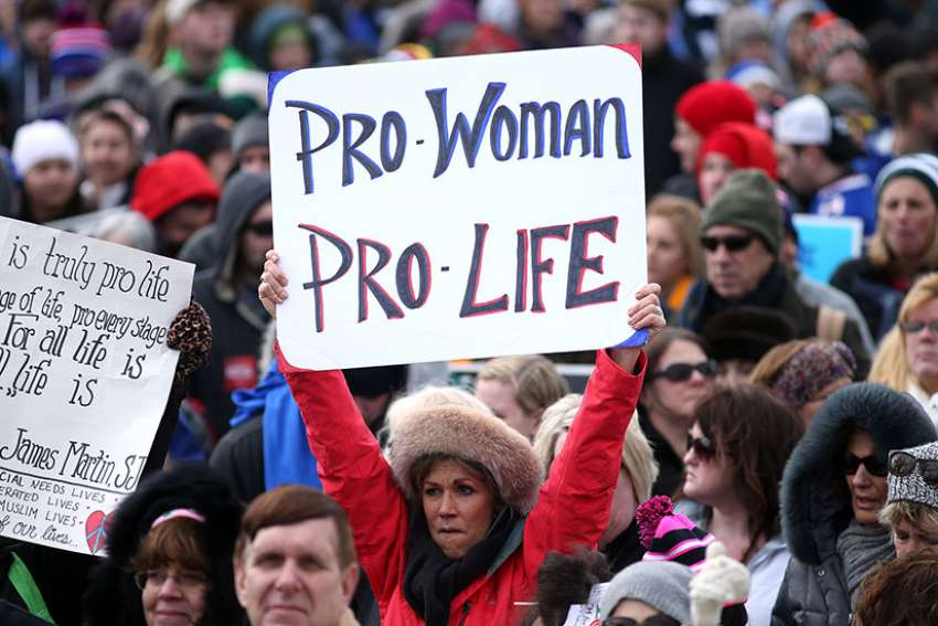 A pro-life advocate holds a sign Jan. 27 during the annual March for Life in Washington D.C.