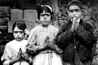 Portuguese shepherd children Lucia dos Santos, centre, and her cousins, Jacinta, left, and Francisco Marto, seen in a file photo taken around the time of the 1917 apparitions of Mary at Fatima. Pope Francis will formally approve the canonization of Jacinta and Francisco April 20.