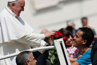 Pope Francis greets family members during his general audience in St. Peter's Square at the Vatican April 15.