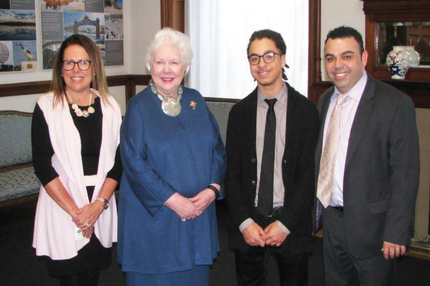 Aaron Parry, second from right, is joined at the Lincoln Alexander Awards  by Josephine Moretuzzo, left, Chair of Guidance at Blessed Trinity Catholic High School; Ontario Lt. Governor Elizabeth Dowdeswell, and Blessed Trinity teacher Antonio Gambale.