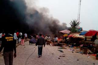 Smoke rises after a bomb blast at the market district in Jos, Nigeria, May 20. Boko Haram has begun occupying churches in Nigeria's northeastern region.