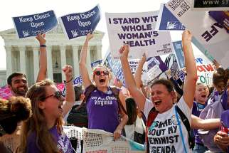 Pro-abortion protesters celebrate when the U.S. Supreme Court struck down two provisions of a 2013 Texas law regulating abortion in the state.