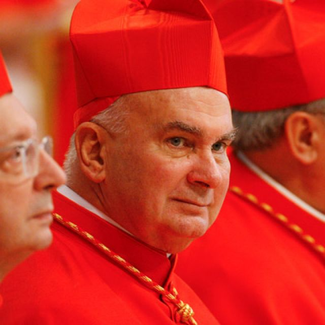 U.S. Cardinal John P. Foley sits among other cardinals after receiving his red biretta from Pope Benedict XVI during a consistory in St. Peter's Basilica at the Vatican in this Nov. 24, 2007, file photo. Cardinal Foley, a dean of the Catholic press in t he United States, died Dec. 11 in Darby, Pa., after a battle with leukemia. He was 76.