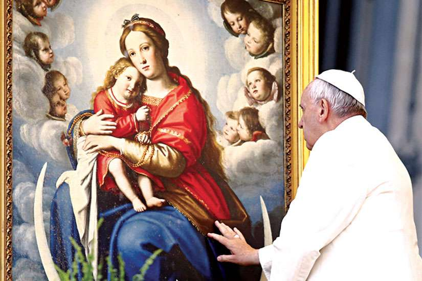 Pope Francis blesses a painting depicting the Virgin Mary with baby Jesus in St. Peter's Square at the Vatican