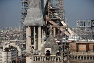 Scaffolding surrounds the damaged Notre Dame Cathedral in Paris April 15.