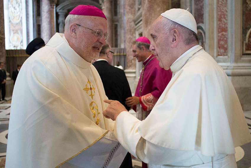 Pope Francis greets Swedish Bishop Anders Arborelius of Stockholm in 2016 at the Vatican. Cardinal-designate Arborelius is one of five new cardinals the pope will create at a June 28 consistory.