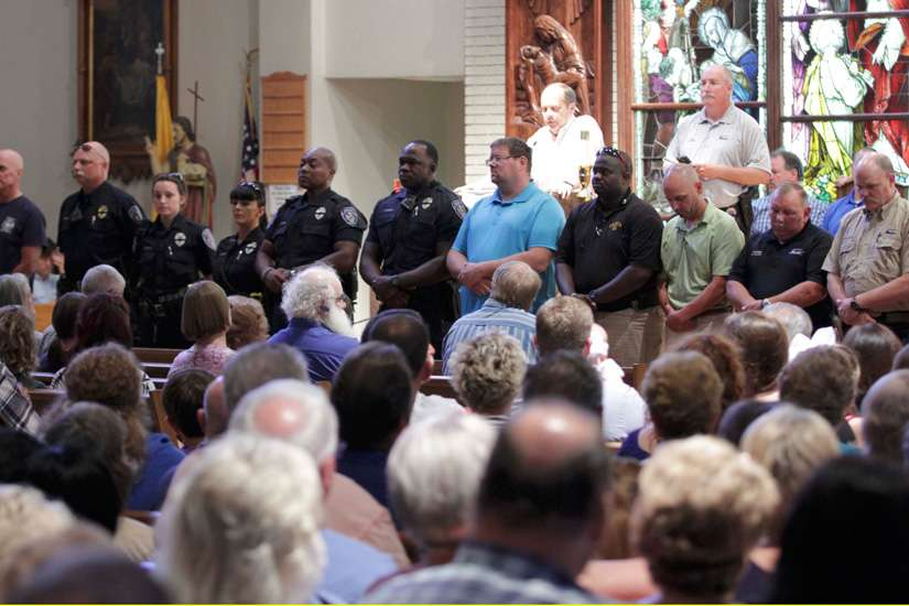 Police officers attend a July 17 vigil at St. John the Baptist Church in Zachary, La., for the fatal attack on policemen in Baton Rouge, La. Since the tragedy unfolded in Baton Rouge, the Catholic community has been at the forefront of efforts for peace and healing.