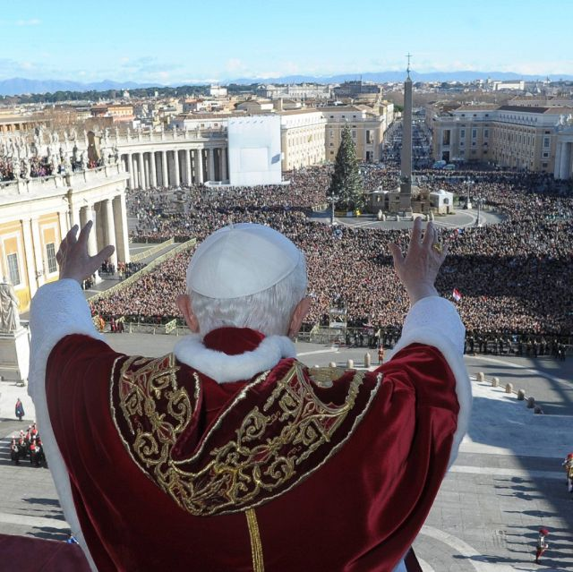 "Pope Benedict XVI delivers delivers his Christmas message ""urbi et orbi"" (to the city and the world) from the central balcony of St. Peter's Basilica at the Vatican Dec. 25."