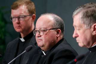 esuit Father Hans Zollner, Archbishop Charles J. Scicluna of Malta and Cardinal Blase J. Cupich of Chicago, all members of the organizing committee for the Feb. 21-24 Vatican meeting on the protection of minors in the church, attend a press conference to preview the meeting at the Vatican Feb. 18, 2019.