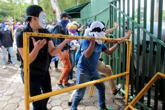 Protesters block the entrance of the Central American University during a Nov. 19, 2019, protest against Nicaraguan President Daniel Ortega's government in Managua, the capital. Supporters of Ortega Nov. 21 tried to enter St. John the Baptist Parish in Masaya, just south of Managua, forcing churchgoers to barricade the doors with pews.