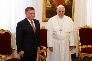 Pope Francis and Jordan's King Abdullah II pose for photos during a private audience at the Domus Sanctae Marthae guesthouse at the Vatican April 7, 2014. The Jordanian king honoured Scarboro Missions for their interfaith efforts in a ceremony April 20, 2015.