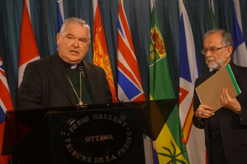 CCCB vice president Archbishop Richard Gagnon of Winnipeg and CCCB president Bishop Lionel Gendron of Saint-Jean-Longueuil at a news conference on Parliament Hill April 18.