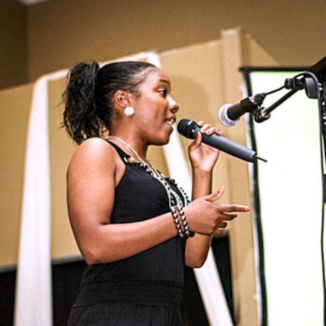 Rapper Shantelle Shakes takes the stage at ACCESS Charity's Arts for Change event.