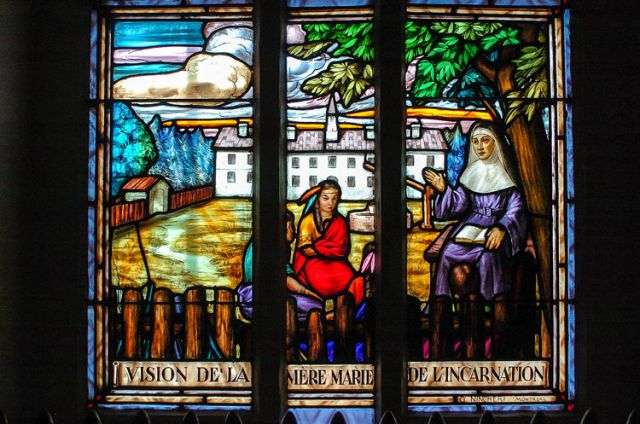 Light shines through the stained-glass window depicting the vision of Saint Marie de l'Incarnation in the chapel at the Convent of Sisters of St. Joseph of Saint-Vallier in Quebec City. Saint Marie was one of three new saints declared by Pope Francis.