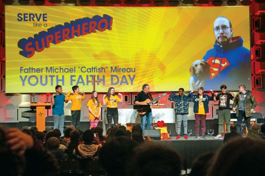 "Cheering, singing and praying, students celebrate Father Michael ""Catfish"" Mireau Youth Faith Day in Edmonton."