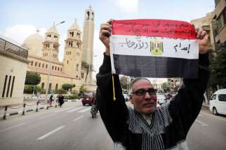 A man in Cairo Feb. 16 denounces the killing of Egyptian Christians in Libya. U.S. Secretary of State John Kerry said atrocities carried out by the Islamic State group against Yezidis, Christians and other minorities were genocide, the first U.S. declaration of genocide since Sudanese actions in Darfur in 2004.