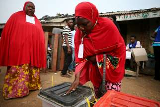 A woman casts her vote during Nigeria's governorship and state assembly election in Karu, Nigeria, March 9, 2019.