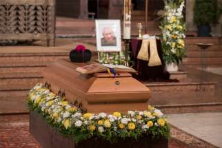 A photo is seen near the casket of Msgr. Georg Ratzinger, brother of retired Pope Benedict XVI, during his funeral Mass at the cathedral in Regensburg , Germany, July 8, 2020.