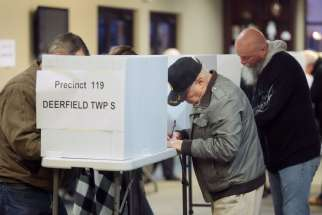 Voters cast their ballots during the presidential election Nov. 8 at a church in Deerfield Township, Ohio.