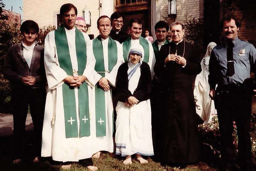Msgr. Ambrose Sheehy stands behind Mother Teresa at the opening of the novitiate of the Missionaries of Charity Fathers in New York City in 1984.