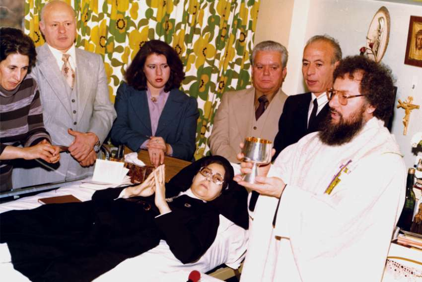 Fr. Claudio Picccinini celebrates Mass in 1977 in the Toronto hospital where Sr. Carmelina Tarantino professed her vows at the first Passionist Sister in Toronto.