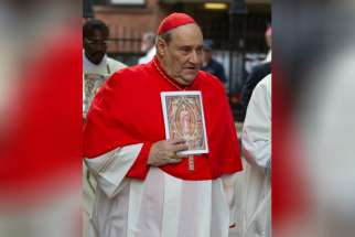 Montreal Cardinal Jean-Claude Turcotte is seen walking outside St. Michael's Cathedral in Toronto on Sept. 14, 2012. The cardinal entered palliative care on Mar. 24, 2015.
