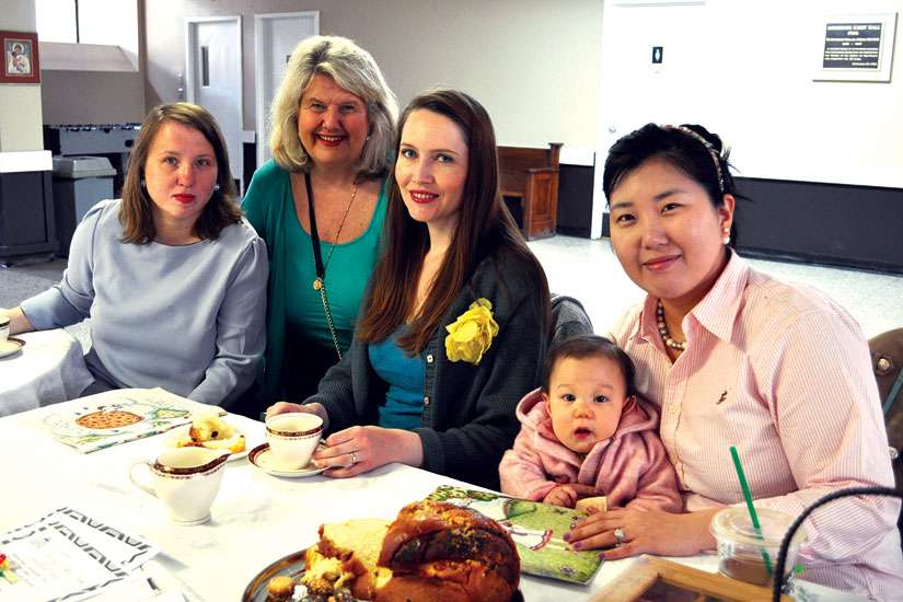 Brenda Ezman, left, is hoping to spearhead a mothers' group at St. Vincent de Paul Roman Catholic Church in Toronto with Liz Santoro, middle, and Liz Nicassio, right. Dorothy Pilarski, second from the left, is leading the archdiocese-wide effort to create more mothers' groups.