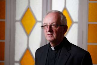 "Father John Fogarty, superior general of the Congregation of the Holy Spirit, is pictured at the order's headquarters in Rome April 20. Father Fogarty said drawing up guidelines for the congregation to prevent sexual abuse ""was the first priority"" after he became superior in 2012."