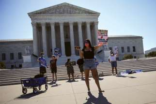 Pro-life activists gather outside the U.S. Supreme Court in Washington June 29.