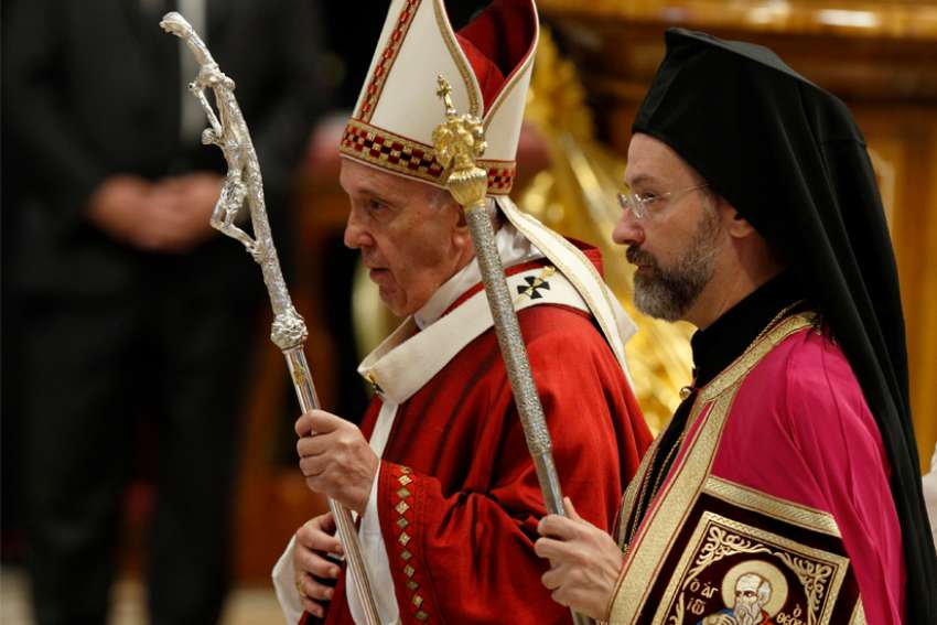 Pope Francis walks with Orthodox Archbishop Job of Telmessos as they leave Mass marking the feast of Sts. Peter and Paul in St. Peter's Basilica at the Vatican June 29, 2019. Archbishop Job was representing the Ecumenical Patriarchate of Constantinople.