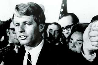 Robert Kennedy, with his wife Ethel in the background, addresses his supporters at the Ambassador Hotel in Los Angeles after winning the California Democratic presidential primary on June 5. Minutes later he was shot.