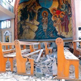 Debris is seen in Im Al-Zinar Church that was damaged during clashes between Syrian rebels and the Syrian regime near Homs.