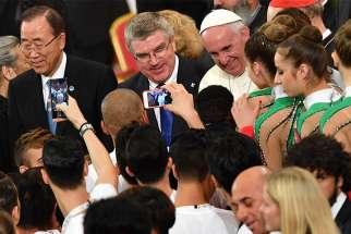 Pope Francis is seen with U.N. Secretary-General Ban Ki-moon, left, and Thomas Bach, president of the International Olympic Committee, during the opening ceremony of a world conference on faith and sport Oct. 5 in the Vatican's Paul VI audience hall in 2016.