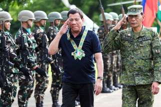 Philippine President Rodrigo Duterte is seen with the military in Carmen, Philippines, June 6. Duterte imposed martial law to combat gunmen claiming to have links with the Islamic State.