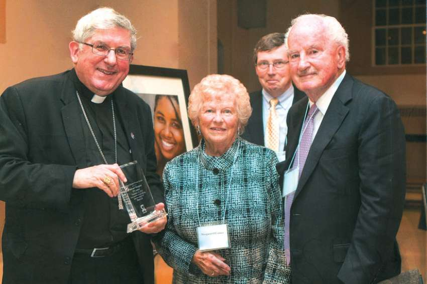 Cardinal Thomas Collins presents Paul and Margaret O'Connor the Bishop Michael Power Award at the ShareLife Mass of Thanksgiving in 2014.